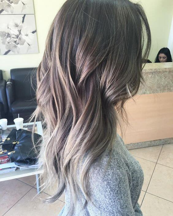 Medium length wavy hair with blonde and gray ombre