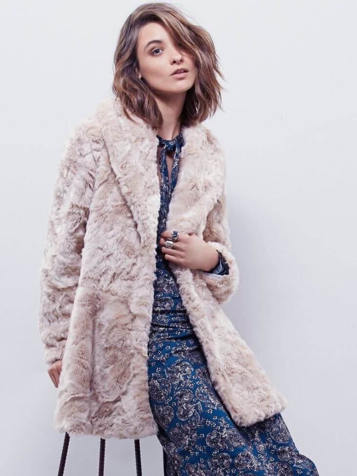Model in white-pink faux fur coat