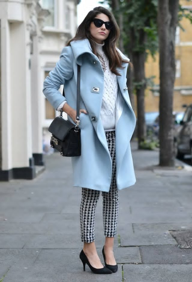 'Airy blue' coat spotted in street style outfits, giving a fresh colorful glance to a black and white fall outfit.