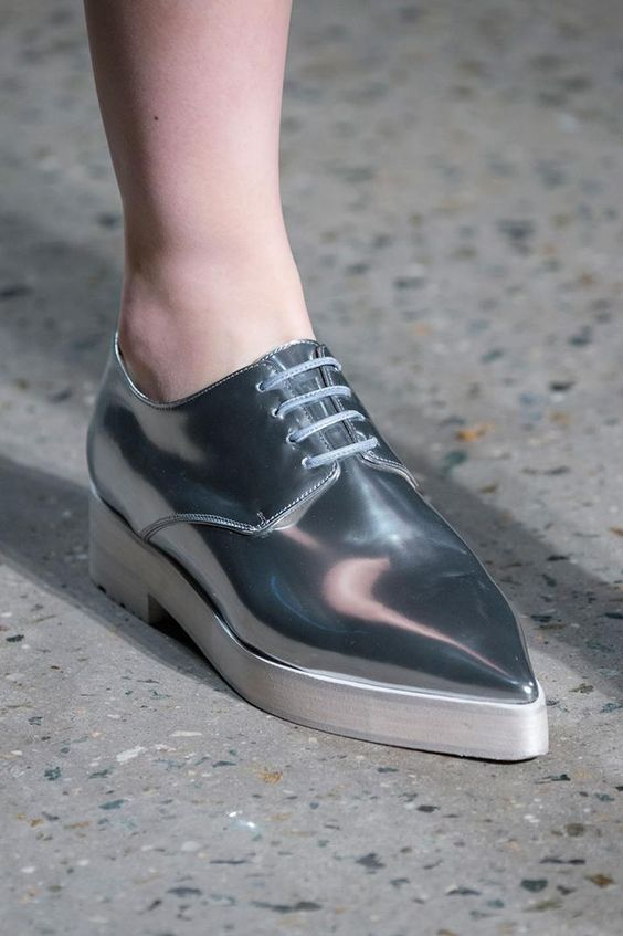 Oxford style shoe in metallic silver with a pointy toe and white platform