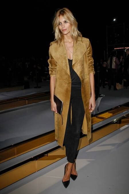 Tall blonde in a long suede coat