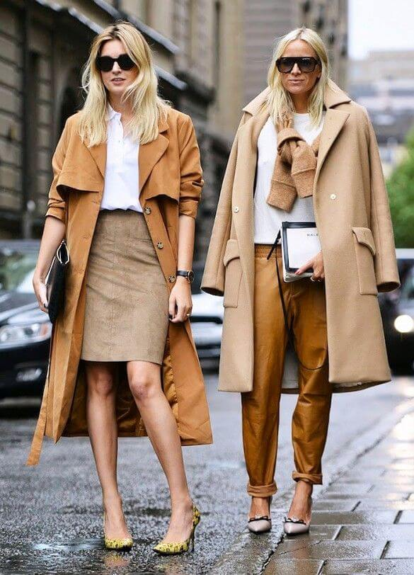 Two blondes on the street wearing suede coat and trousers
