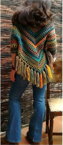 Loosely knitted colorful poncho.