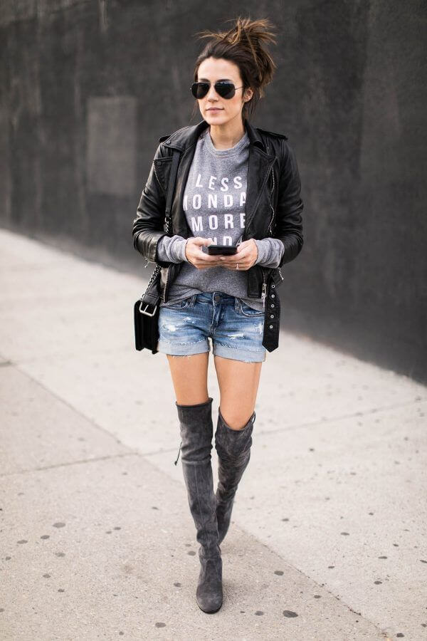 Biker jacket combined with shorts and high boots.