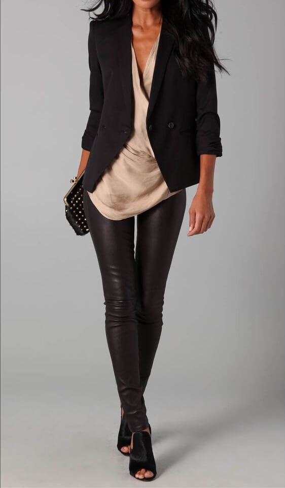 Woman in black leather pants, draped beige top and black blazer with black peep-toe shoes
