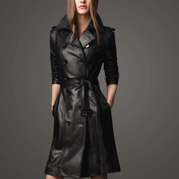 Woman in black leather trench coat
