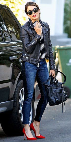 Woman wearing blue denim skinny jeans with a striped top, black leather jacket and red stiletto heels