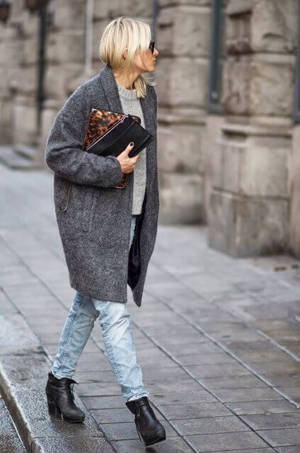 Cocoon coat with sweater and jeans underneath.