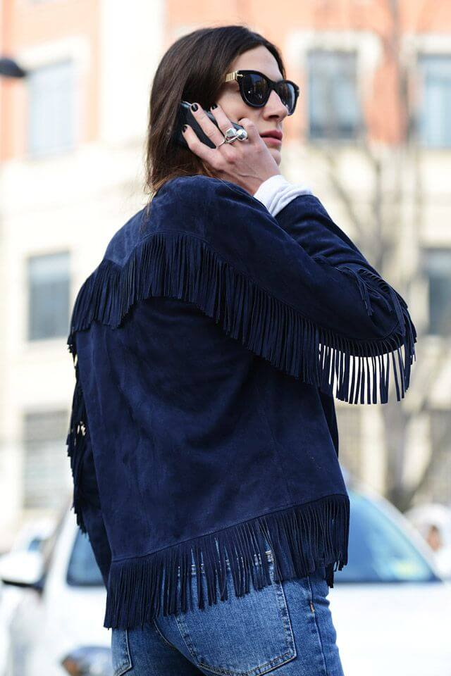 Woman in dark blue suede jacket