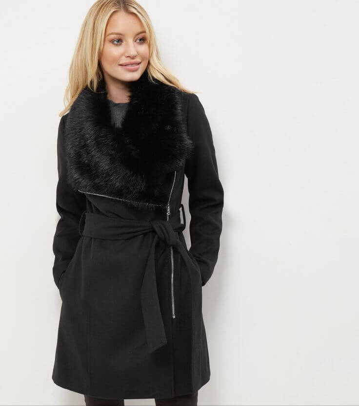 woman in faux fur trimmed casual coat