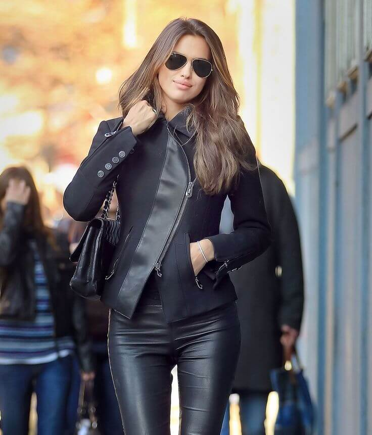 Woman in leather trousers and jacket with leather details