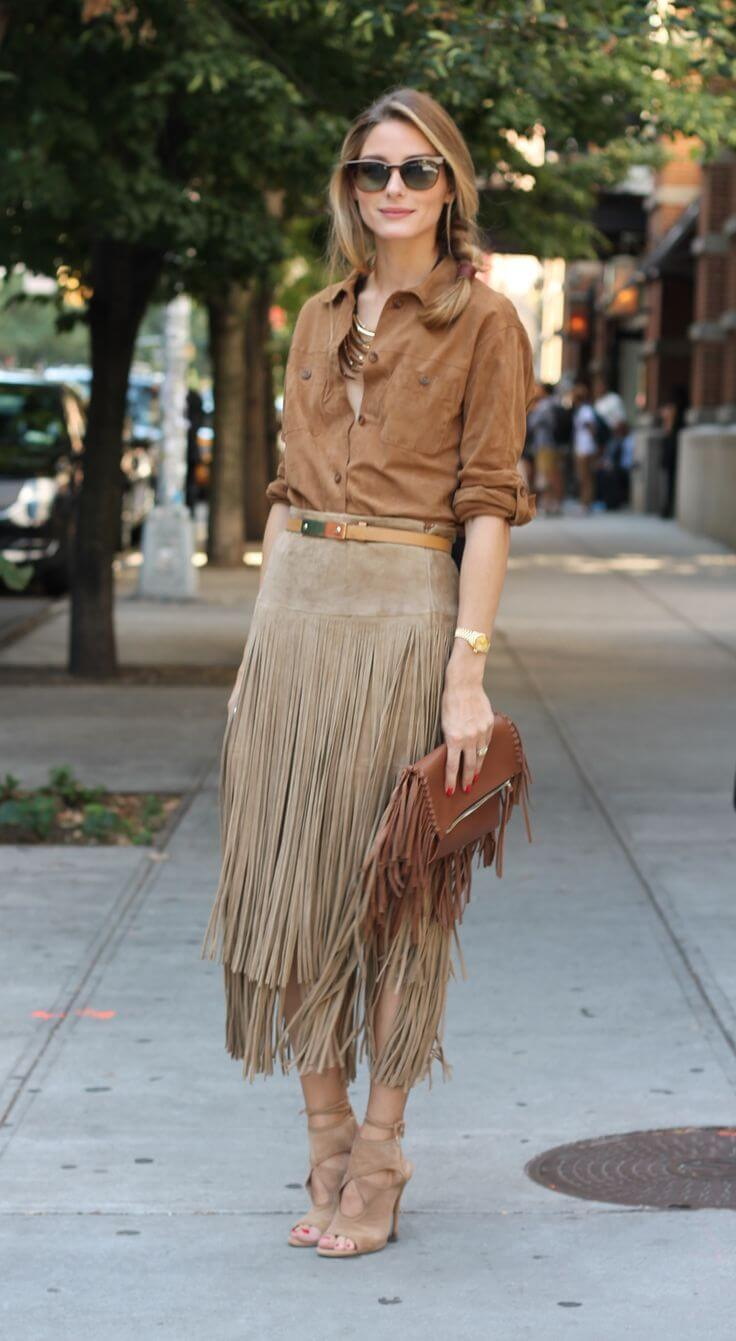 Woman in maxi fringed suede skirt