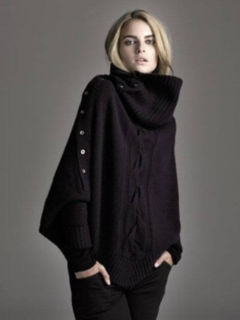 Oversized knitted sweater with batwing sleeves and high neck.