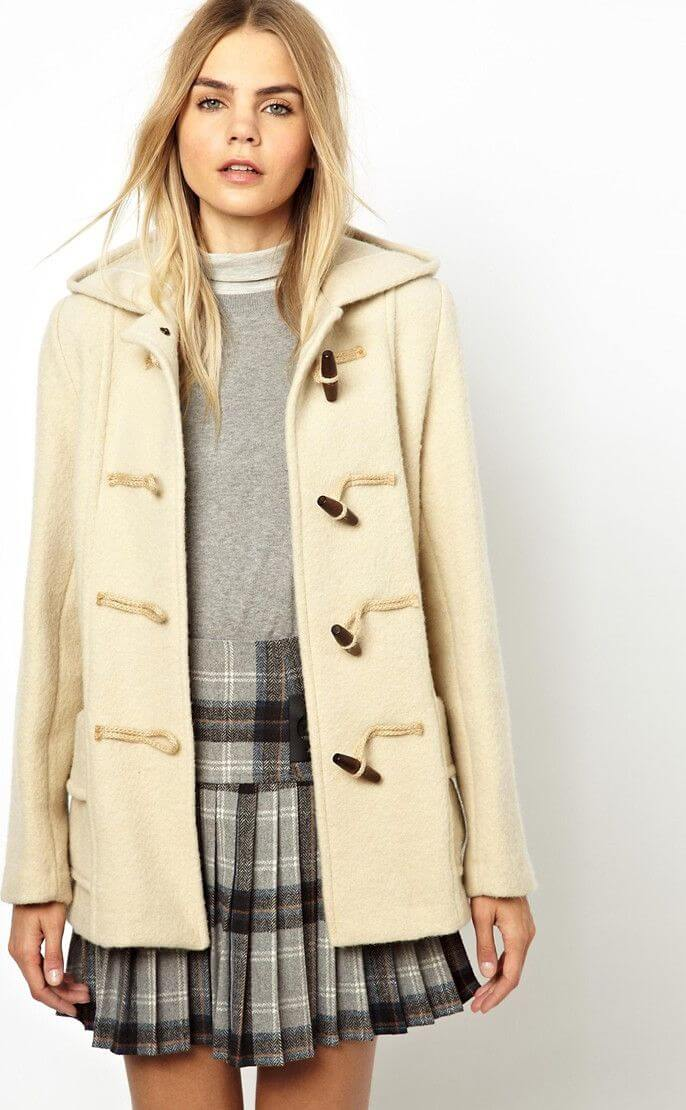 Duffle coat combined with skirt.