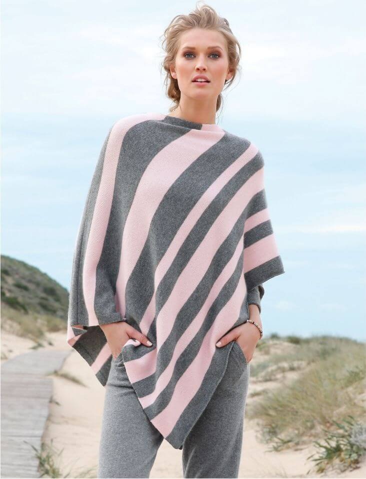 woman on the sand dunes wearing a cashmere poncho