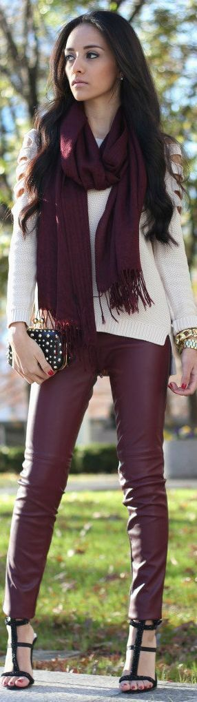 Burgundy leather trousers.