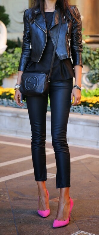 Woman wearing black leather pants and black leather moto jacket