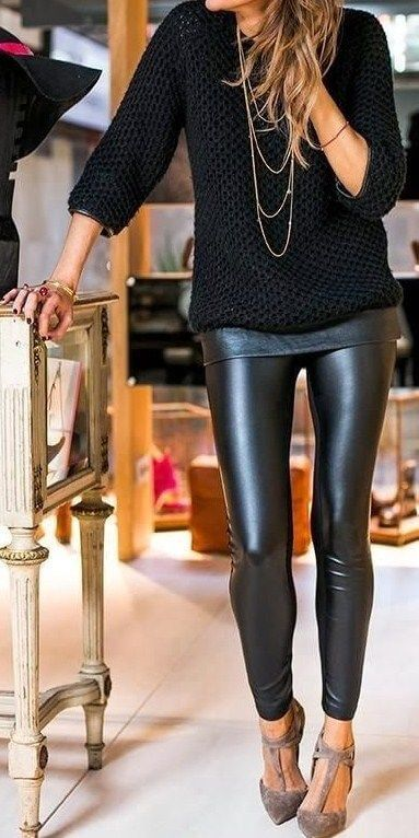 Woman wearing black leather pants, black woolen jersey and pointy beige T-bar heels