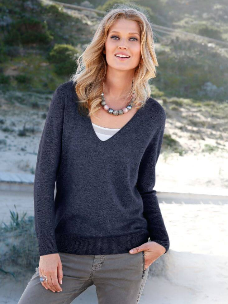 Woman wearing V-neck cashmere sweatshirt