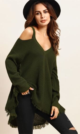 A woman is wearing a green sweater with black pants
