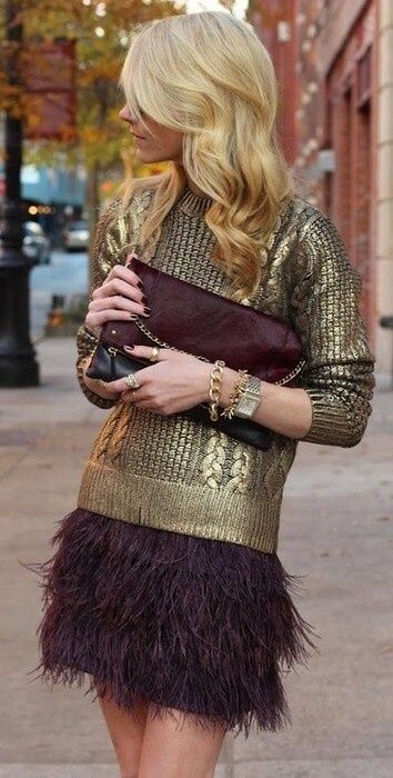 A woman is wearing a metallic gold sweater with skirt