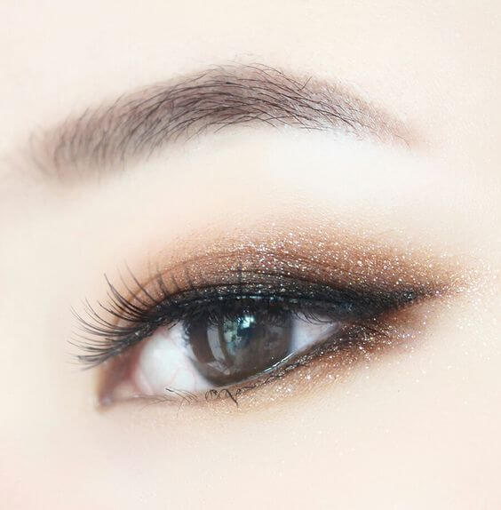 Close up of an Asian eye with black eyeliner and beige eyeshadow