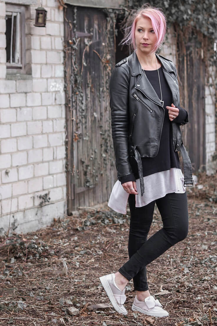 Woman in dark leather jacket