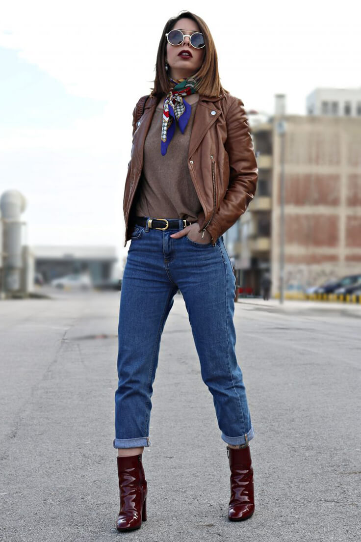 Woman in jeans and leather jacket