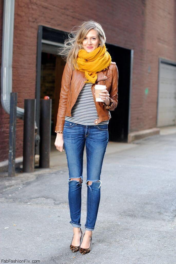 A bright yellow wrap scarf adds warmth to this cozy fall outfit.