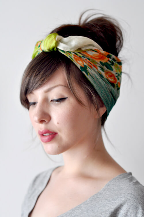 A brunette is wearing a headband scarf