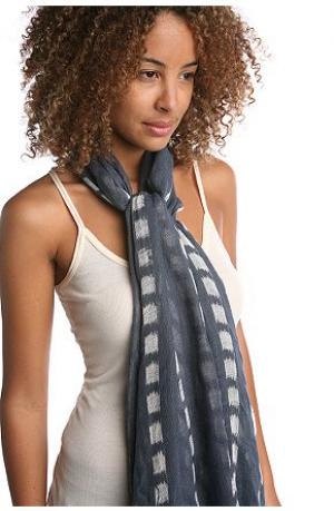 A model is wearing a scarf and a top
