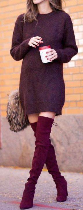 Beautiful brunette in a berry-colored oversized sweater and burgundy boots
