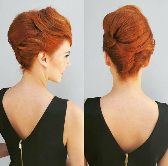 Channel your inner Joan Holloway with this layered twist updo.