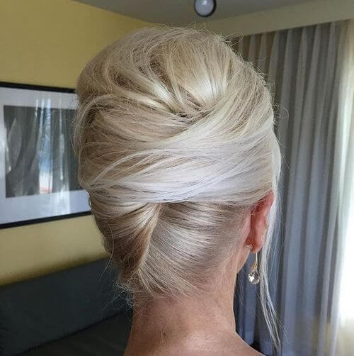 Blonde bouffant hairstyle with French twist updo