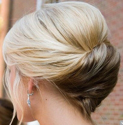 Blonde updo twisted diagonally across the back of the head