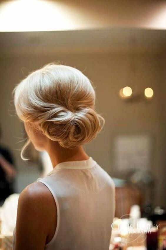 blonde updo with hair rolled into a horizontal twist