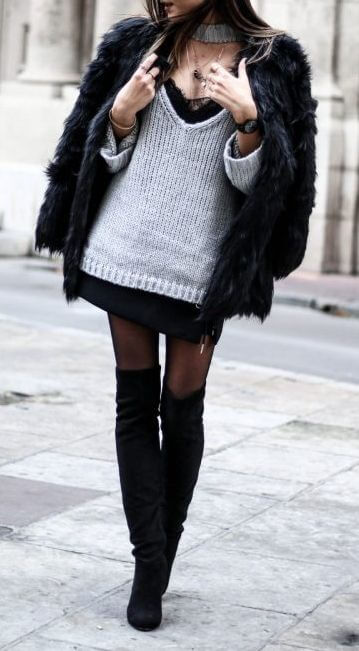 Chic brunette in a grey oversized sweater and faux-fur coat