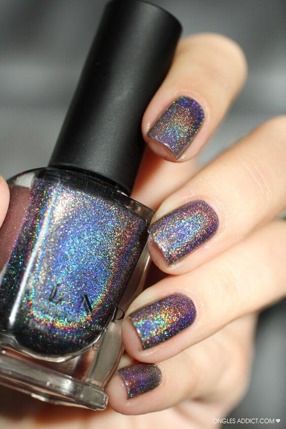 This holographic polish has more dark blue and purple hues, but still reflects rainbow light.