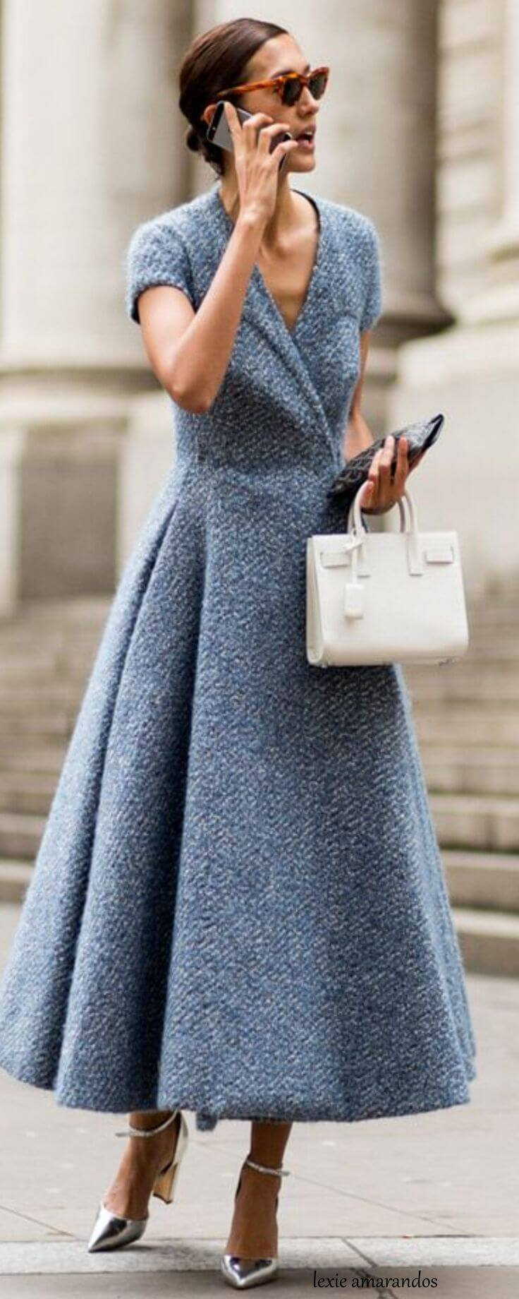 Elegant woman in a cold stone blue wool dress