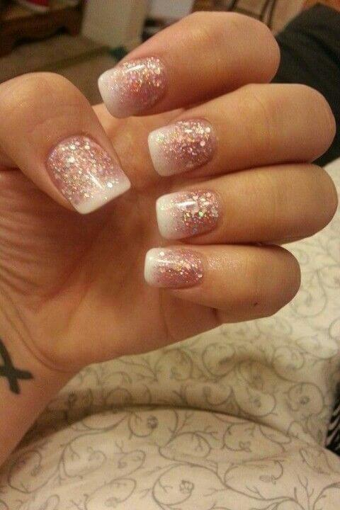 gel manicure with pink glitter base and white flat tips