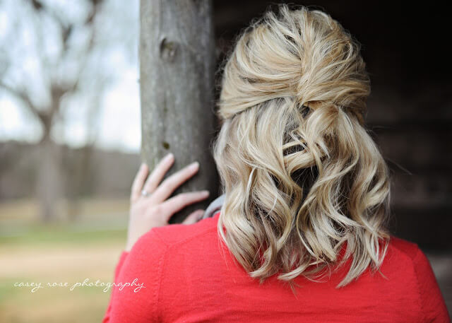 Medium-length wavy hairstyle with the top portion of hair tucked into a French twist
