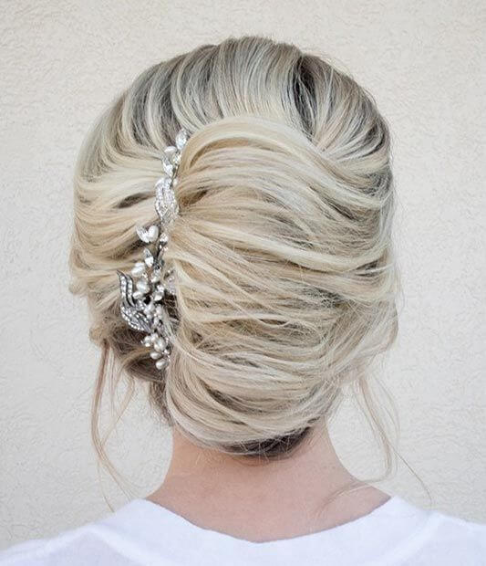 Loose French twist with long silver sparkly comb
