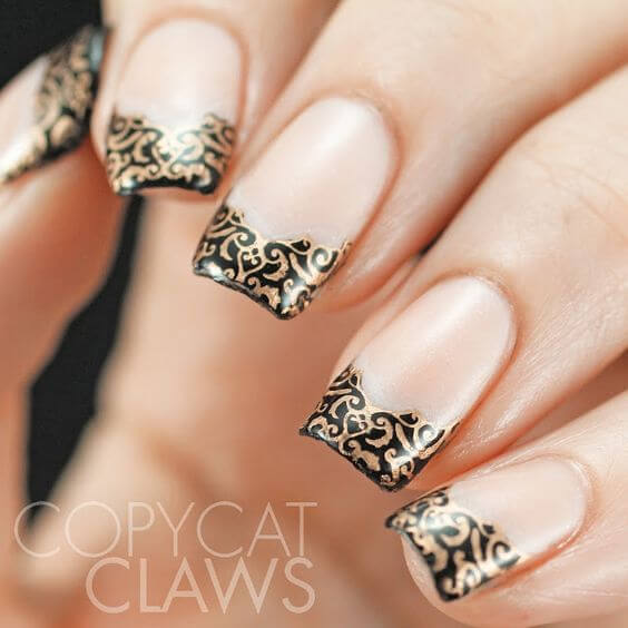 Stunning and artistic, these nails were inspired by intricate lace patterns.