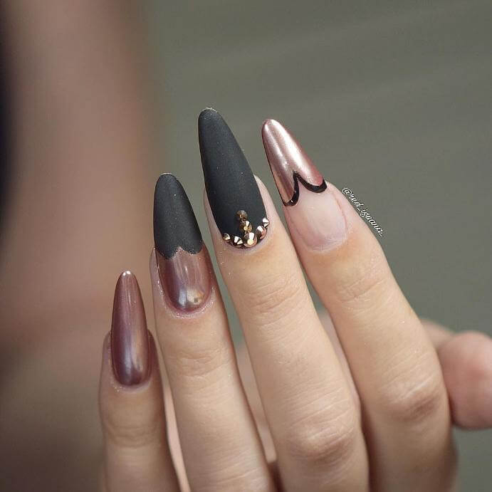 Using both matte black, metallic pink, and clear nail polish, this artist has created a unique look.