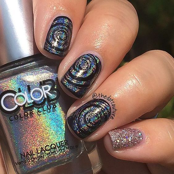 26 awesome mirror and metallic nail art ideas belletag metallic swirl design on black nail polish with chunky glitter accent nail prinsesfo Choice Image