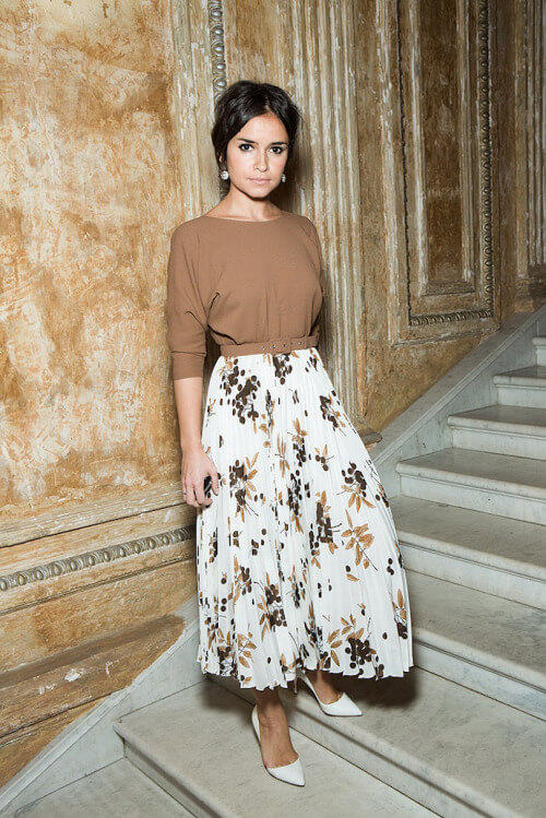 Miroslava Duma twists a modest look to stylish elegance by wearing a blouse and a floral skirt