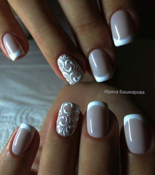 nail design with beige polish with a rounded white tip and accent nail with  delicate white - 35 Splendid French Manicure Designs: Classic Nail Art Jazzed Up