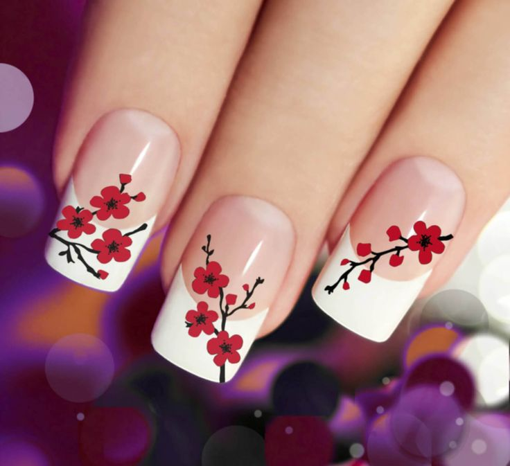 Nude nail polish with white tips and red cherry blossom design
