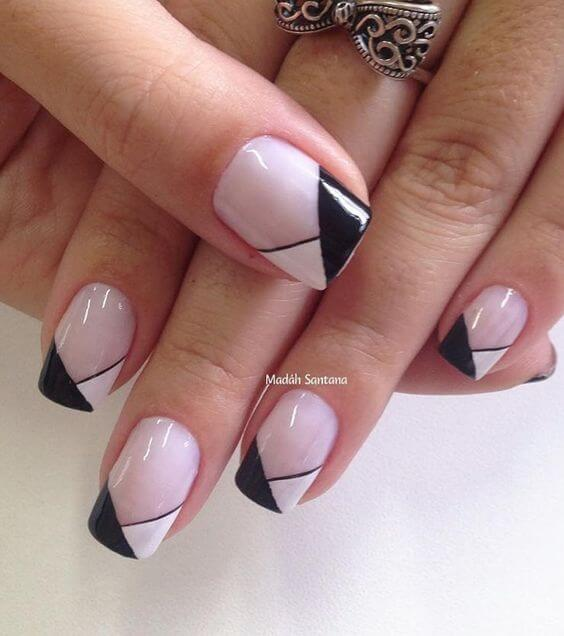 Pale Pink Nail Polish With Triangular Black And White Tip Designs