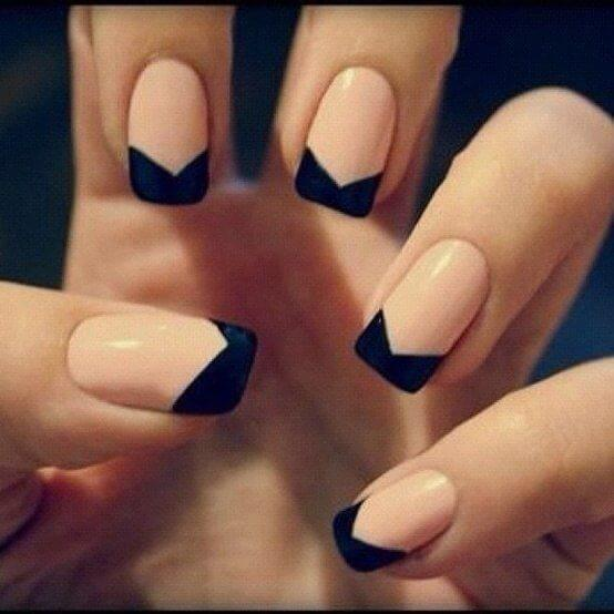 pale pink nail polish with triangular black tips